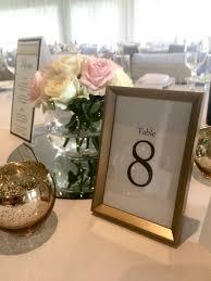 gold table number frames table numbers cloud nine weddings