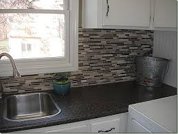 Costco Kitchen Countertops by Costco Backsplash On Black Granite Like Counter With White