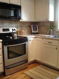 Refinishing White Kitchen Cabinets Tutorial Painting Fake Wood Kitchen Cabinets