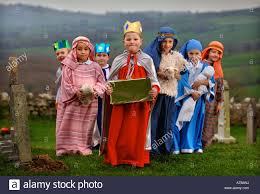 children in costume before a primary school nativity play in a
