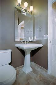 Small Bath Solution Seems Elegant Tropical Powder Room Design - Powder room bathroom