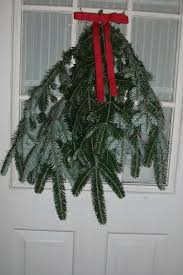 making a pine door swag with christmas tree clippings monkeybean