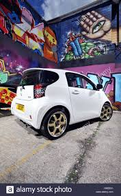 modified toyota modified toyota iq sub compact city car and graffiti wall stock