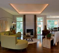 fireplace chic living room with ceiling lighting and curved sofa