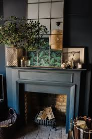 a gorgeous dark and moody eclectic and glamorous living room