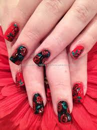 red and black polish with freehand rose nail art nails