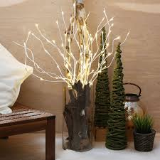 Plants For Living Room Decorating Lighted Branches With Potted Plants And Coffee Table