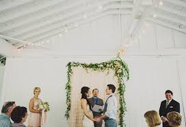 wedding backdrop garland rustic nashville wedding 100 layer cake