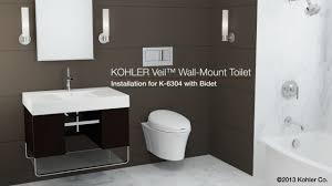 Bathroom Tile Flooring by Bathroom Tile Floor With Round Kohler Toilets Seats And Glas