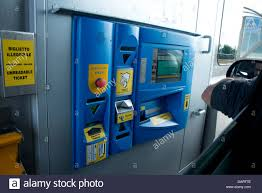 photo booth machine driver at blue italian toll booth machine on autostrada in tuscany