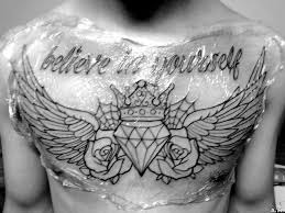 heart with crown tattoo design on chest photos pictures and