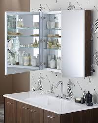 bathroom zebra wall paper with mirror medicine cabinet also