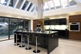 sleek kitchen design feat glossy black island also skylight
