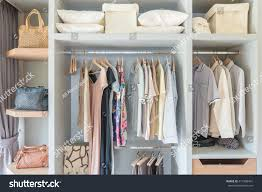 clothes hanging on rail wooden closet stock photo 417368401