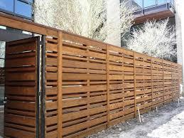 stained wood fence horizontal backyard fence ideas