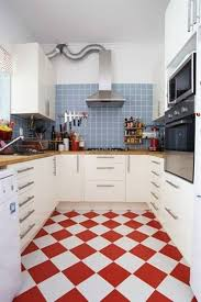 easy red white kitchen floor tiles with blue wall and black oven