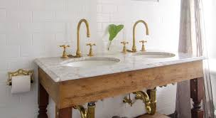 Polished Brass Bathtub Faucets Vintage Brass Widespread Bathroom Faucets On A Marble Sink With