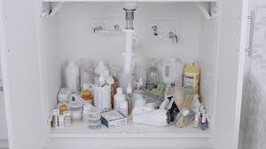 how to organize small bathroom cabinets how to organize your bath sink cabinet the container