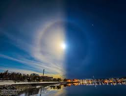 this photo shows a halo created by both the sun and the moon