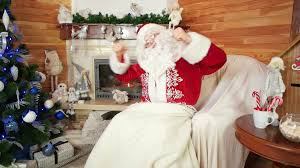 dancing santa x mas party room with fireplace and decorated