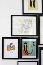 two rules of thumb for hanging things on your walls smile and wave