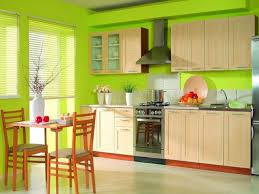 light green wall color plus cream wooden kitchen island with glass