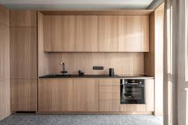 wooden kitchen cabinets modern wood cabinets without hardware are a consistent feature