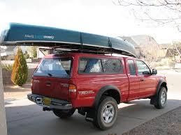 canoe on truck w cap thule tracker ii roof rack system s