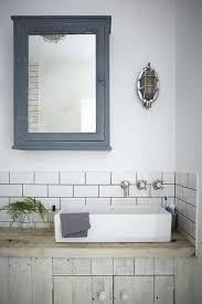 powder room bathroom with dark vanity vessel sink full height