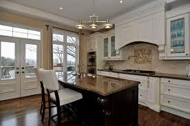 dark hard wood flooring and white kitchen extravagant home design