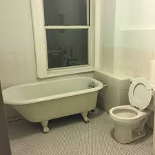 bathroom modern toilet with clawfoot tubs and daltile wall plus