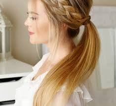 hair braided into pony tail side braid into a ponytail ladystyle