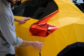 lexus umbrella uk nissan gets jealous of lexus and folds a life size origami replica