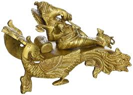 brass statue ganesha sitting on a peacock chariot hindu idol for