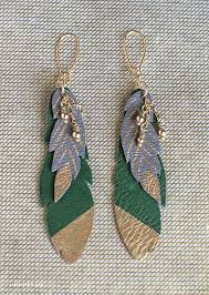 make feather earrings diy leather feather earrings leather earrings feathers and leather