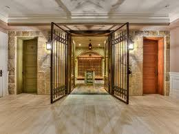Temperature Controlled Wine Cellar - decorative iron gates in front of glass doors that open into
