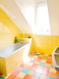 charming yellow bathroom decor combined with colorful ceramics