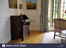 A Bureau Writing Desk In Lounge Of Country House Uk With Mullioned