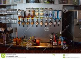 bar counter variety of hard liquor bottles at bar counter editorial stock