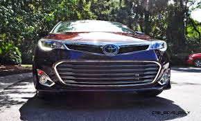 lexus es vs toyota avalon road test review 2015 toyota avalon hybrid