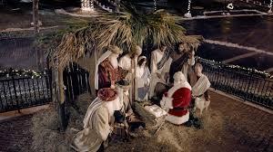 santa kneeling at the manger santa s priority 60