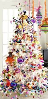 white christmas tree with multicolor lights whimsical lollipop christmas tree filled with candy decor winter