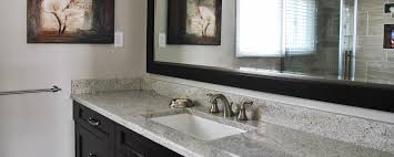 granite countertop white kitchen cabinets with black appliances