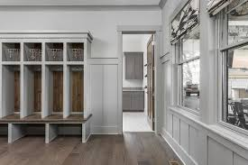 gray mudroom lockers with barn board trim transitional laundry