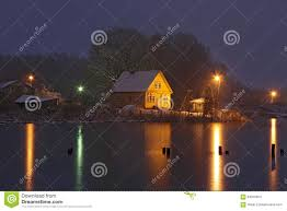 Light Yellow House by Yellow House On Frozen Lake At Night Stock Photo Image 64040647