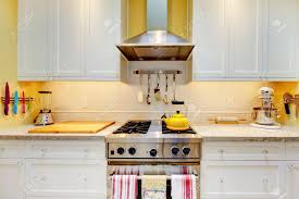 Yellow Kitchen With White Cabinets by Narrow White And Yellow Kitchen With Cabinets Close Up Stock