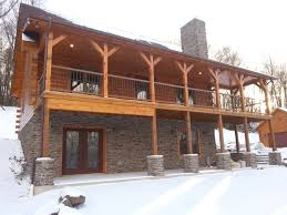 complete customization good things in small packages exterior of custom log home with walk out basement and stone pillars timberhaven log