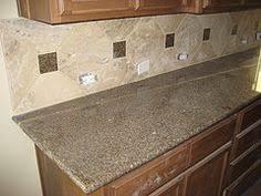 Tiled Kitchen Backsplash Below And Behind The Microwave And Stove - Large tile backsplash