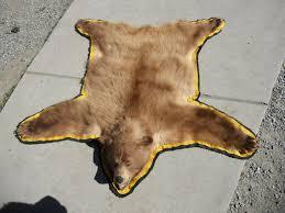 cinnamon black bear rug by minotaur queen on deviantart