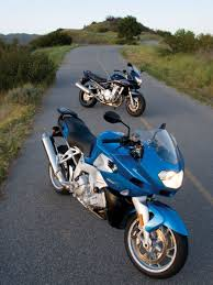 bmw k1200r and suzuki bandit 1250s mc comparison motorcyclist